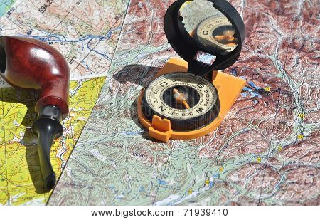 Map, Compass And Pipe Smoking Area.