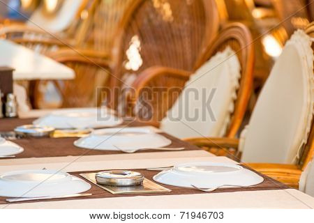 Laid Tables In A Summer Cafe In The Resort