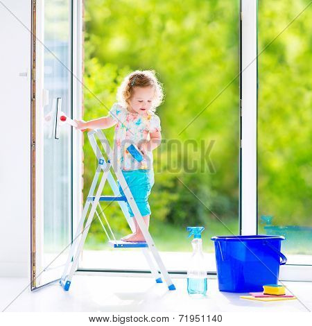 Beautiful Little Girl Washing A Window