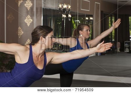 Young Women in Yoga Poses