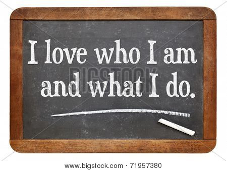 I love who I am and what I do - positive affirmation words on a vintage slate blackboard
