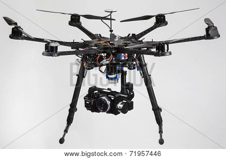 A hexacopter with a camera isolated on a white background poster