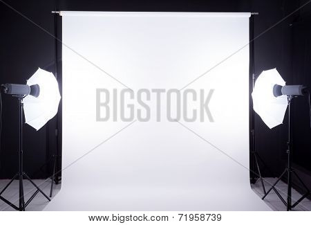 Modern photo studio with lighting equipment