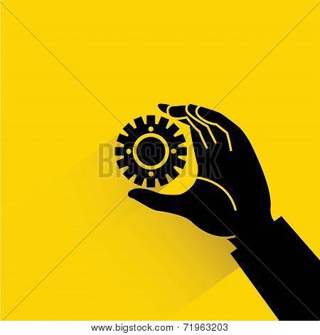 hand holding gear