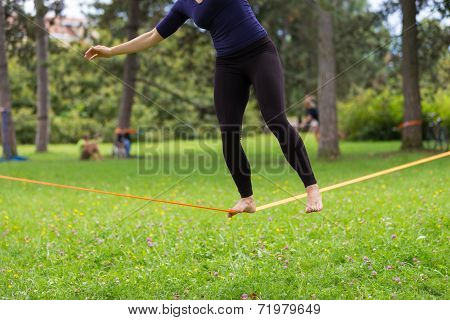Slack line in the city park.