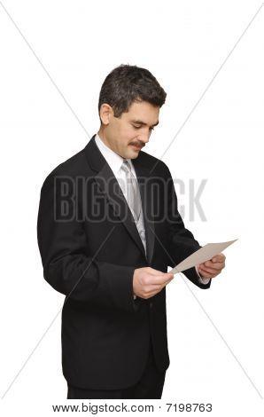 Groom Looking At Marraige License