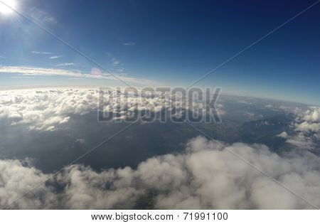 Aerial View - Clouds, Sun and Blue Sky - 4500m