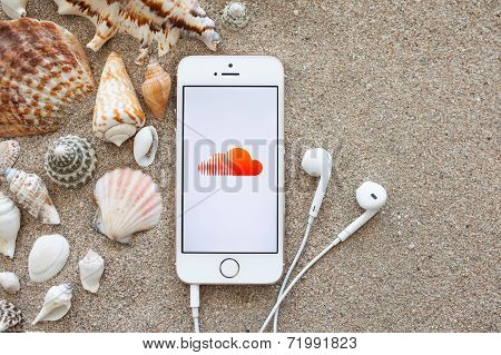 White Iphone 5S With App Sound Cloud On The Screen Lying On The Sand With Shells