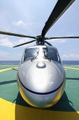 helicopter parking landing on offshore platform. Helicopter transfer crews or passenger to work in offshore oil and gas industry. poster