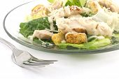 Chicken Caesar salad isolated on a white background with crutons and thick creamy dressing poster
