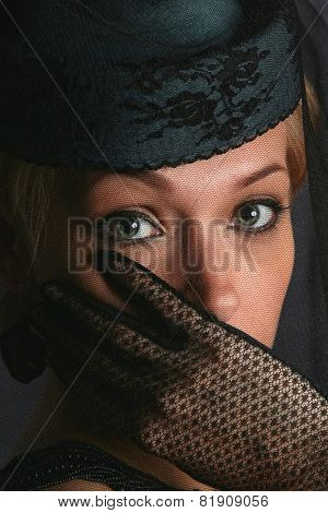 The woman with a black veil