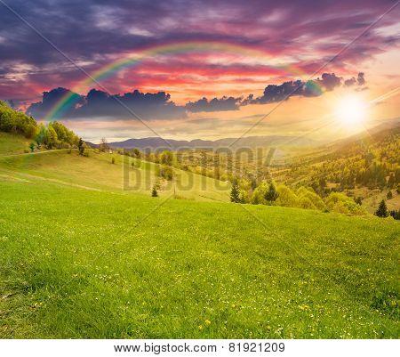 Village On Hillside Meadow At Sunset