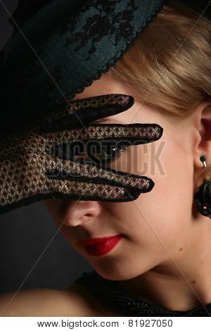 The woman look between fingers