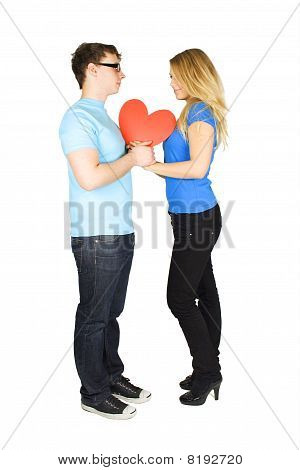 Young Man In Glasses And Blond Girl Holding Red Paper Heart, Looking To Each Other, Isolated On Whit