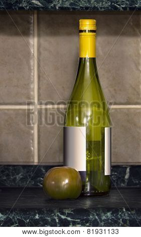 Empty Wine Bottle And One Tomatoes