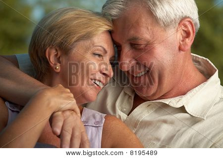 Mature Couple Smiling To Each Other