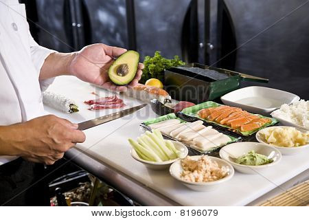 Japanese Chef In Restaurant With Sushi Ingredients