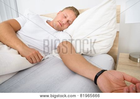 Man Sleeping Wearing Smart Wristband