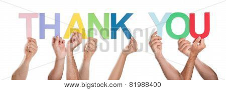 Close-up Of Hands Holding The Word Thank You