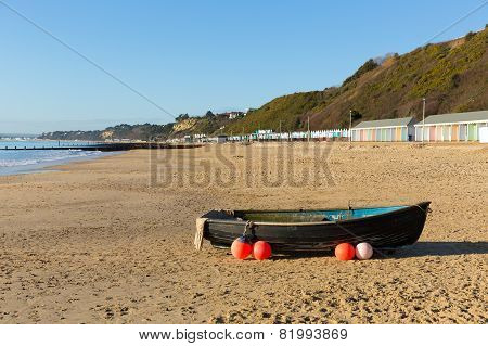 Boat on Bournemouth beach Dorset England UK near to Poole known for beautiful sandy beaches