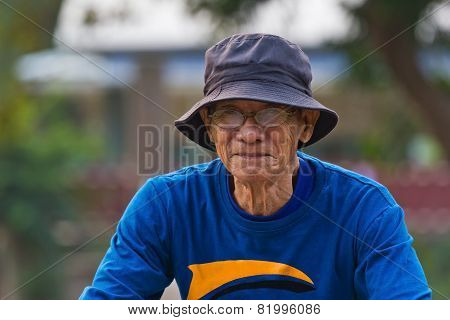 Active Senior Man Riding A Bicycle On Countryside