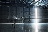 Lone drone U.A.V aircraft awaiting a military mission in a hanger. 3d model scene. poster