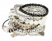 Pile of Various Pearl Silver and Black Jewelry Gems Bracelets isolated on white background poster