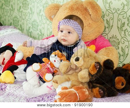 Cute Little Girl Embraces Toys