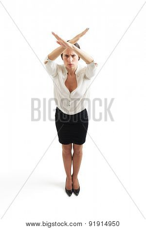 angry woman in formal wear crossing her hands overhead. isolated on white background