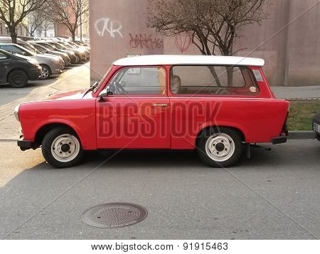 PRAGUE CZECH REPUBLIC - CIRCA MARCH 2015: Red Trabant car parked in a street of the city centre