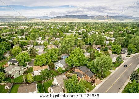 FORT COLLINS, CO, USA -May 28, 2015: Aerial view of Fort Collins at springtime, a typical residential street along Front Range of Rocky Mountains in Colorado with 30 years old houses