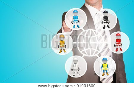 Businessman pressing on holographic screen with puppet people in colorful clothes poster