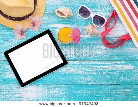 Blank empty tablet computer on beach. Summer accessories  pool.