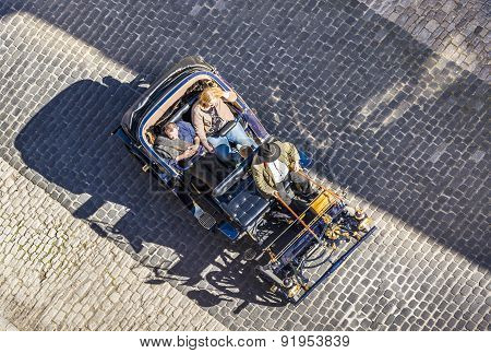 Guide Waits For Tourists With An Old Vintage Car In Rothenburg