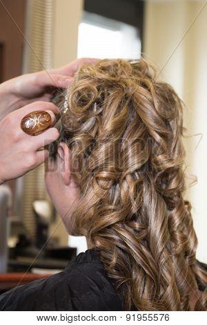 Smiling Young Woman Hairdo At Hairdressing Salon Doing A Bun