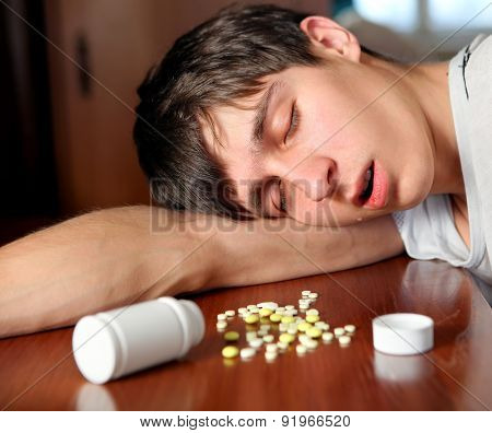 Young Man Sleep With The Pills