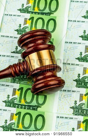 gavel and euro banknotes. symbol photo for costs in court, rule of law and auctions