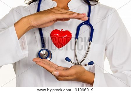 a young doctor (internist) holding a heart symbolically in hand.