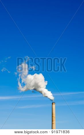 Smokestack And Vertical White Smoke On Blue Sky.