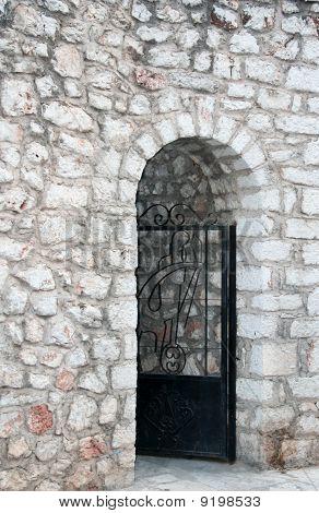 Simple, Timeworn Gateway In Greece