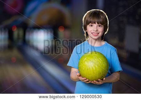 Smiling boy in bowling