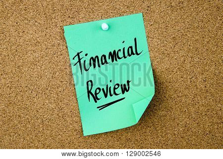 Financial Review Written On Green Paper Note