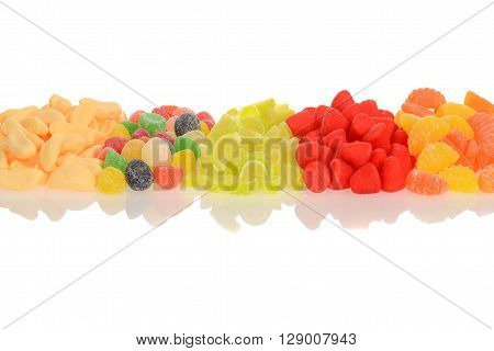 row of assorted candy with white background