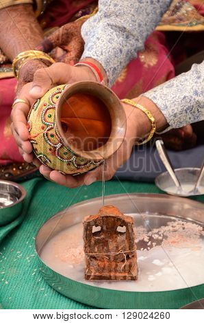 A Indian Men Performing Indian Rituals For His Wedding