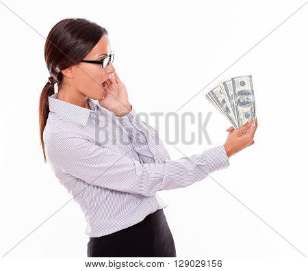 Surprised Brunette Businesswoman Looking At Money