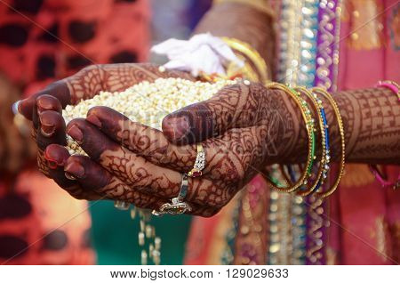 A Indian Bride Performing Indian Rituals For Her Wedding
