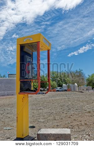 A public payphone with the receiver off the hook