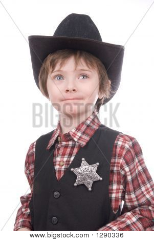 Young Sheriff Boy Wearing A Marshals Badge