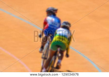 Bike race on velodrome track blurry for background