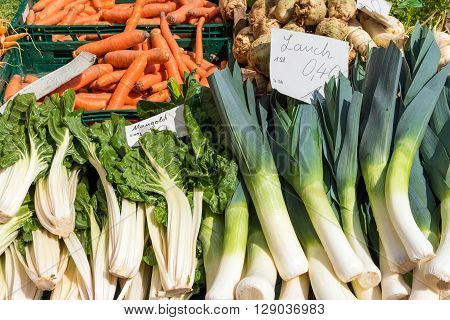 Leek, mangold and carrots for sale at a market